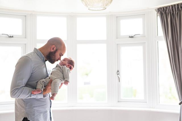 dad and newborn baby girl